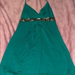Green halter top with sequin embellishments